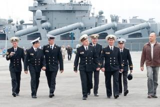 Russian Navy officers and the Slava-class cruiser Varyag. (Flickr Kenneth Lu)