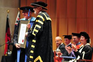 Chancellor Gareth Evans AC QC presents A/Professor Foley with the VC's citation