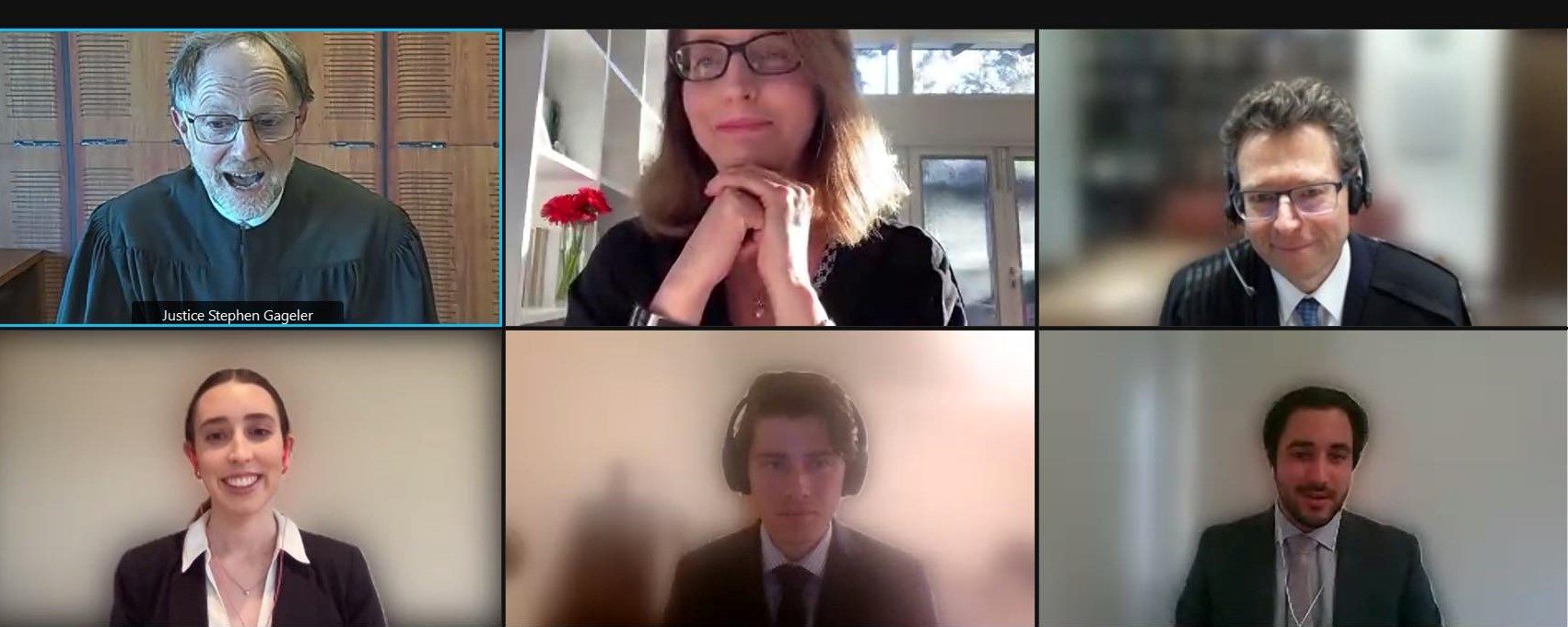 The three ANU participants in the Sir Harry Gibbs Constitutional Law Moot appear in a Zoom gallery view with the three judges.