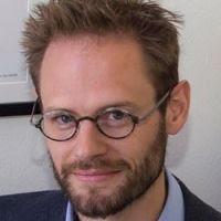 A photograph of Associate Professor Will Bateman.