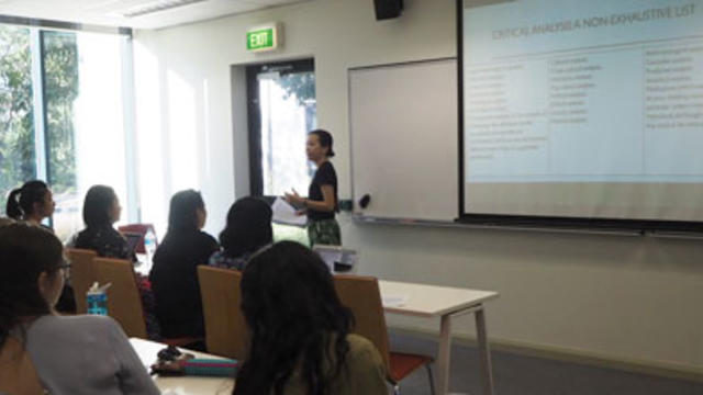 Image shows students attending essay writing workshop