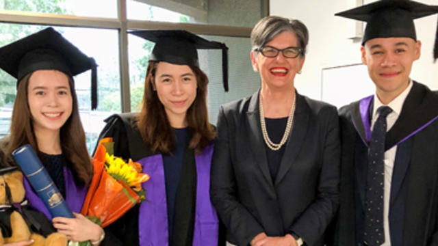 The Tang Siblings and Professor Spender at graduation day