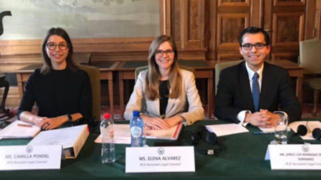 Camilla Pondel, left, and two colleagues at the Permanent Court of Arbitration
