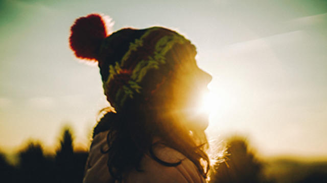 Girl with sun in the background
