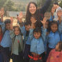 Law student Christina Lee with children in Nepal