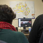 ANU Law students Skype with KCLS solicitors at the hot desk. Image: Stuart Hay