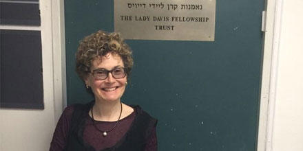 Professor Rubenstein stands in front of a sign which says The Lady Davis Fellowship Trust