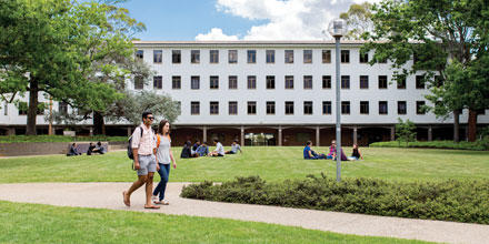 Image shows students walking past ANU law link building