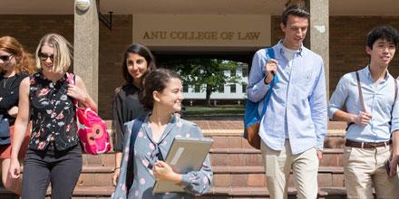 Image shows students walking through ANU Law doorway