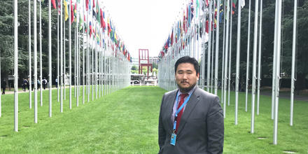 Batzorig Enkhbold standing proudly outside the United Nations Office in Geneva