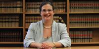 Dr Dominique Dalla-Pozza smiling