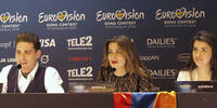 Image shows three singers at Eurovision press conference