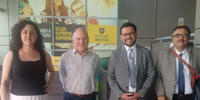 Image shows Associate Professor David Letts, second from left, with three officials from Universidad Mayor in Chile