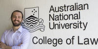 Ross Mackey in front of the ANU Law College