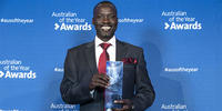 JD student Elijah Buol smiles as he holds the 2019 Queensland Local Hero award. Image courtesy National Australia Day Council