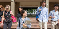 Image shows students walking through ANU Law doorway
