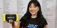 ANU Student Christina Lee,smiling  holding a Koombook