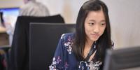 Jessica Sidi sitting at her work desk