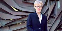 Professor Pauline Ridge stands outside Menzies Library