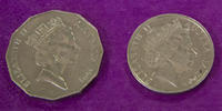 Image shows two Australian coins featuring head of Queen Elizabeth II, photographed against a purple background